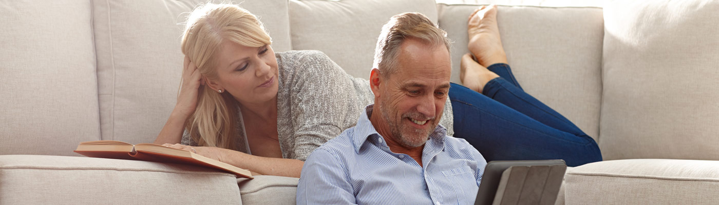 Couple relaxing on couch in their manufactured home